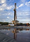 stock photo of drilling platform  - Land drilling rig working in Indonesia under a beautiful blue sky - JPG