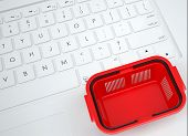 stock photo of qwerty  - Shopping basket on the keyboard - JPG