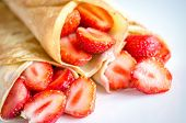 image of crepes  - Crepes With Fresh Strawberries On The Square Plate  - JPG