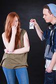 foto of drug dealer  - Drug dealer and addicted teenage girl on isolated black background - JPG