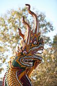 stock photo of serpent  - The head of the serpent with many heads decorate the temple stairs - JPG