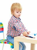 pic of montessori school  - Little boy draws felt - JPG
