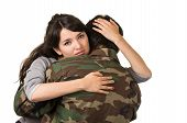 foto of say goodbye  - young woman and soldier in military uniform say goodbye deployment isolated on white - JPG