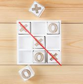 picture of tic  - Game of Tic Tac Toe on wooden background - JPG