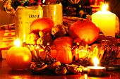 image of satsuma  - Glass bowl filled with walnuts hazelnuts and mandarin oranges with Christmas presents to the rear - JPG