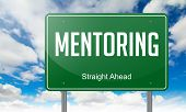 pic of mentoring  - Highway Signpost with Mentoring wording on Sky Background - JPG