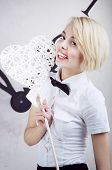 picture of office romance  - cute blonde office girl smiling and holding a white heart sign - JPG