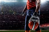 foto of adults only  - American football sportsman player in open stadium - JPG