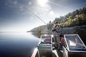 image of bass fish  - Men is fishing on the bass boat - JPG