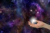 stock photo of mudra  - Gyan Mudra Hand Position creating the Spark of Life on a deep space background with planets - JPG