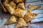 picture of samosa  - indian samosa filled with chicken curry on tray - JPG