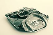 picture of life after death  - Crushed beer can- life was severely passed after it... ** Note: Shallow depth of field - JPG