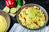 pic of tabouleh  - Couscous with grilled chicken meat and vegetables fresh lime on top - JPG