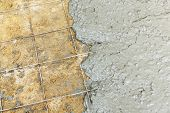 stock photo of concrete pouring  - Close up wire mesh and wet cement in concrete floor pouring process - JPG