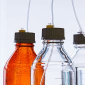 image of chromatography  - Close up clear and amber color bottle with plastic hose for High performance liquid chromatography  - JPG