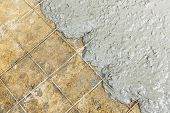 image of concrete pouring  - Close up wire mesh and wet cement in concrete floor pouring process - JPG