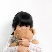 pic of pyjama  - Little child in pyjamas holding teddy bear - JPG