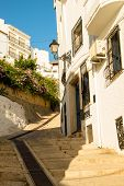stock photo of costa blanca  - Street in old town Altea Costa Blanca Spain - JPG