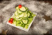 stock photo of christmas meal  - A Christmas tree salad made with cucumber and cherry tomatoes a healthy kid meal - JPG