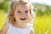 picture of rape-seed  - happy toddler girl in rape seed field - JPG