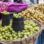 stock photo of nepali  - The street vendor sels his fruits and vegetables in Thamel in Kathmandu Nepal - JPG