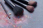 Image of set of make up brushes on black background.