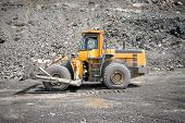 image of open-pit mine  - Wheel bulldozer working in career in open - JPG