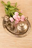 foto of pompous  - antik table set with pink tulips on a table - JPG