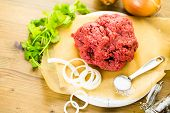 image of ground-beef  - Ground beef on the table with other ingredients for recipe. ** Note: Shallow depth of field - JPG