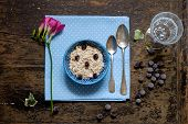 stock photo of porridge  - Breakfast oatmeal porridge with blueberries flower breakfast - JPG