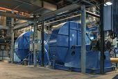 picture of generator  - Electric Industrial generator inside power plant closeup - JPG