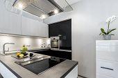 stock photo of granite  - Superb luxury kitchen with granite worktop in black and white style  - JPG
