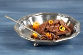 foto of orange peel  - Chocolate with orange peels and coffee beans in metal tray on wooden background - JPG