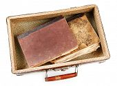 pic of old suitcase  - Old wooden suitcase with old books isolated on white - JPG