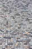 stock photo of cobblestone  - Abstract texture of gray cobblestone pavement as background - JPG