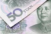 picture of yuan  - Chinese 50 yuan notes overlaid detail banknotes - JPG