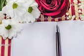 image of single white rose  - white paper sheet and bouquet of red roses and white daisy - JPG
