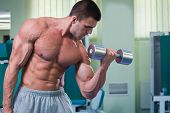 stock photo of dumbbell  - Man at the gym - JPG