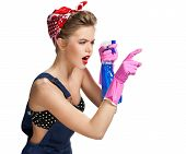 picture of cleaning service  - Thinking cleaning woman wearing pink rubber protective gloves holding spray bottle  - JPG