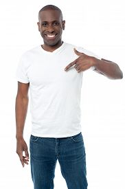 stock photo of middle finger  - Middle aged man pointing his fingers on a blank t - JPG