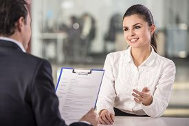 image of candid  - Businessman interviewing female candidate for job in office - JPG