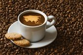 stock photo of continent  - Still life photography of hot coffee beverage with map of Asia continent - JPG
