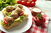 image of meatball  - Meatball Sandwiches on wooden table background - JPG