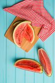 picture of watermelon slices  - Closeup of watermelon slices on wooden vintage background - JPG