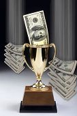 stock photo of money prize  - American money winner in a gold trophy - JPG