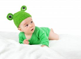 pic of baby frog  - little baby in knitted frog hat on soft blanket - JPG