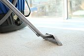 Steam vapor cleaner removing dirt from carpet in flat poster