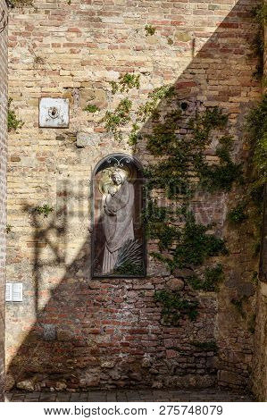 Old Statue Of Madonna With