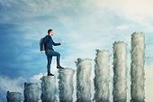 Confident Man Climb Up To The Top Of A Graph Made Of Clouds Over Blue Sky Background. No Limits Grow poster