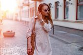 Fashionable Young Hipster Woman In Stylish Sunglasses In Trendy White Dress With A Fashionable Brown poster
